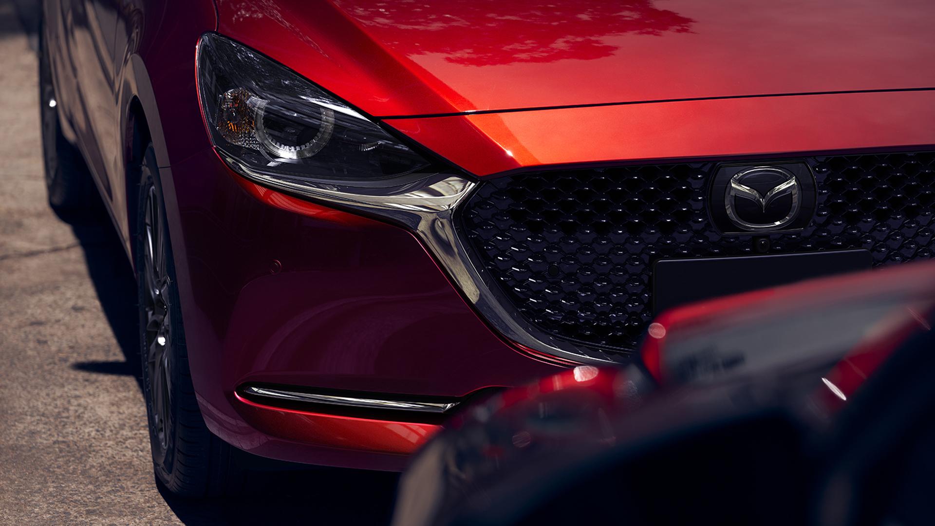 Mazda показала обновленную «двойку»